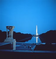 Night view of the Washington Monument across the National Mall by American School